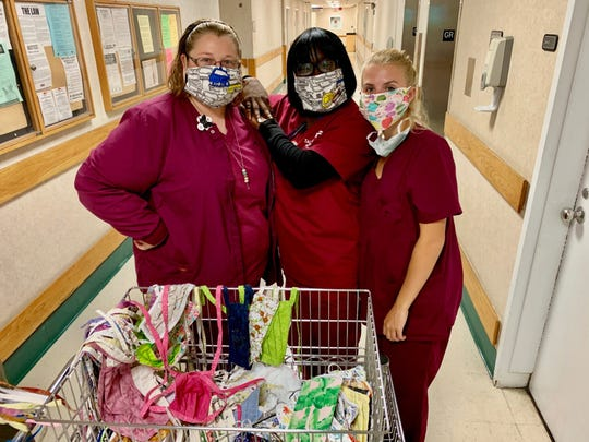 TMH health care works with donated masks. AS TMH continues to fight COVID-19 in Tallahassee, all donations of cloth face coverings and commercial PPE are both welcomed.