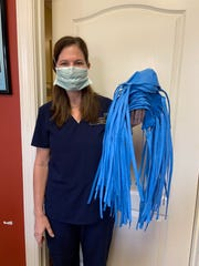 Kristen Costa, Physician's Assistant, with masks made at Southeastern Plastic Surgery.