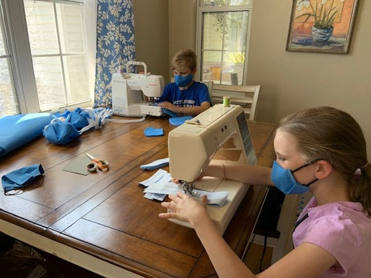 Buck Lake Elementary student Jacob Mayfield, age 10, makes masks with his sister, Alexis, 8.