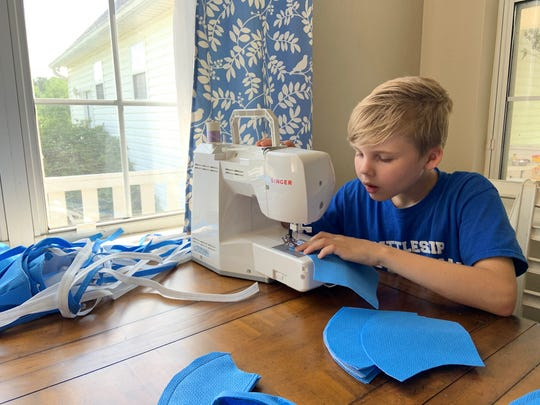 Jacob Mayfield, age 10, Buck Lake Elementary School. works on making a mask.