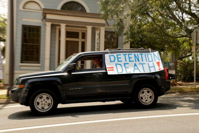 """Around 20 vehicles made laps around the Capitol complex and Department of Corrections' Carlton Building making noise with car horns and yelling over bullhorns, calling for the """"decarceration"""" of those in prisons and jails in order to stop the spread of COVID-19 among them Monday, April 13, 2020."""