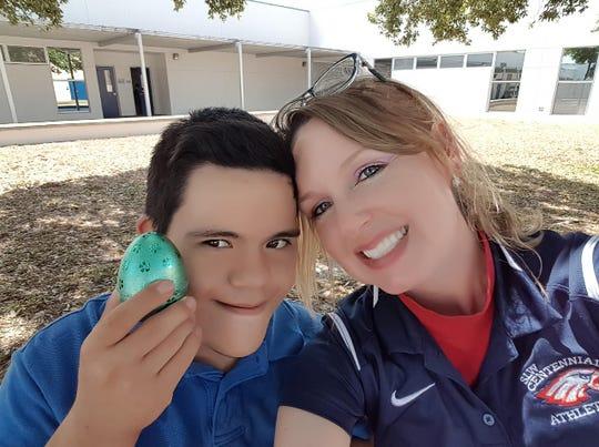 Jose Zacapa, 19, with Lauren Walker, St. Lucie West Centennial High School's exceptional student education teacher.