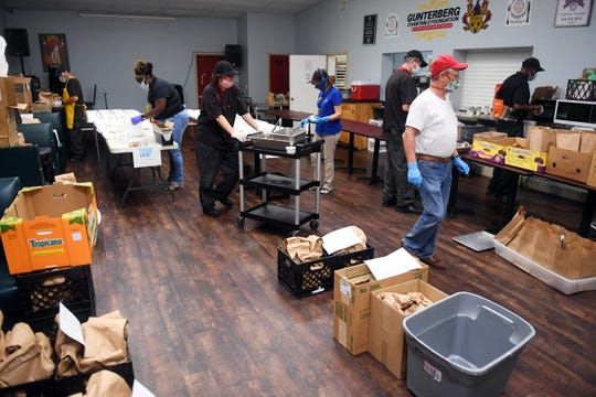 Staff and students at The Source, a faith-based ministry for the homeless, use the main room to organize meals made daily for delivery or pickup on Monday, April 13, 2020, in Indian River County.