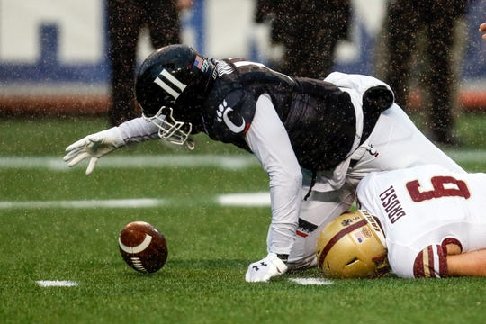 Cincinnati linebacker Bryan Wright (11) reaches for a fumbled ball as he tackled Boston College quarterback Dennis Grosel (6) during the first half of the Birmingham Bowl NCAA college football game Thursday, Jan. 2, 2020, in Birmingham, Ala. (Photo/Butch Dill)