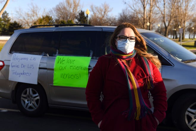 In this Thursday, April 9, 2020 photo, Nancy Reynoza, director of Que Pasa Sioux Falls, who organized a protest in solidarity with Smithfield Food, Inc. employees after many workers complained of unsafe working conditions due to the COVID-19 outbreak in Sioux Falls, S.D. The pork processing plant in South Dakota is closing temporarily after more than 80 employees tested positive for the coronavirus.