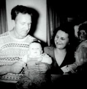 Susan Manzke's father, Chuck Paska, holding baby Susan in 1950 while her mother, Isabelle, looks on, often told stories of his childhood to Susan and her sister at bedtime.