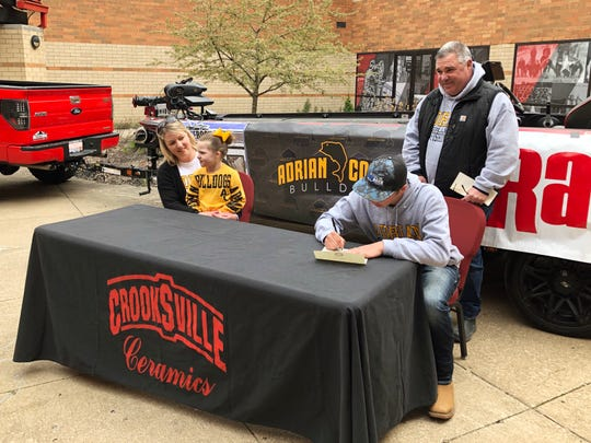 Crooksville senior Kobe Thompson signs hit letter of intent with Adrian (Michigan). Thompson, one of the top-ranked junior anglers in the country, earned a full scholarship.