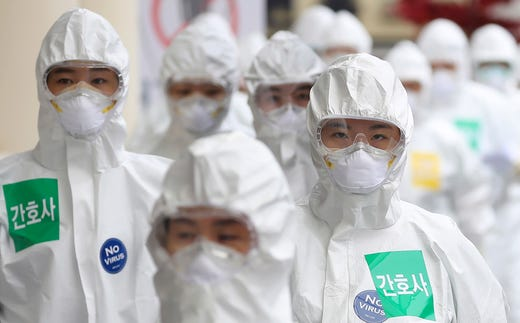 Medical staff members arrive for a duty shift at Dongsan Medical Center in Daegu, South Korea, April 13, 2020.