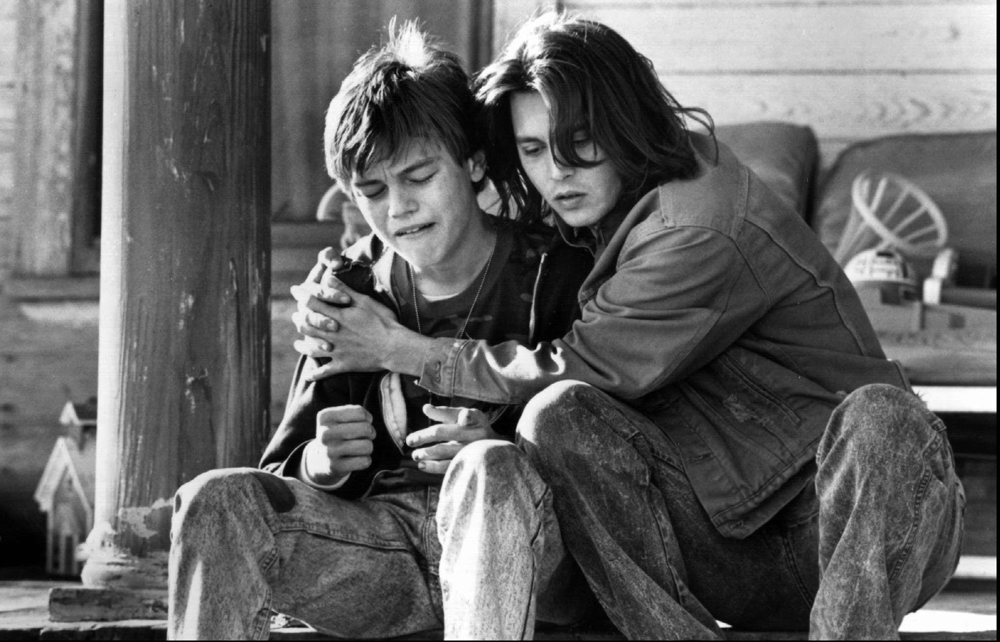 "Leonardo DiCaprio (left) plays the mentally impaired younger brother of Johnny Depp's caring title character in""What's Eating Gilbert Grape."""