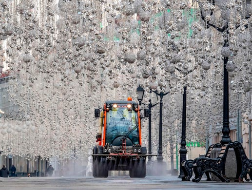 A municipal vehicle cleans Nikolskaya street in downtown Moscow on April 13, 2020, during a strict lockdown in Russia to stop the spread of the COVID-19 coronavirus.