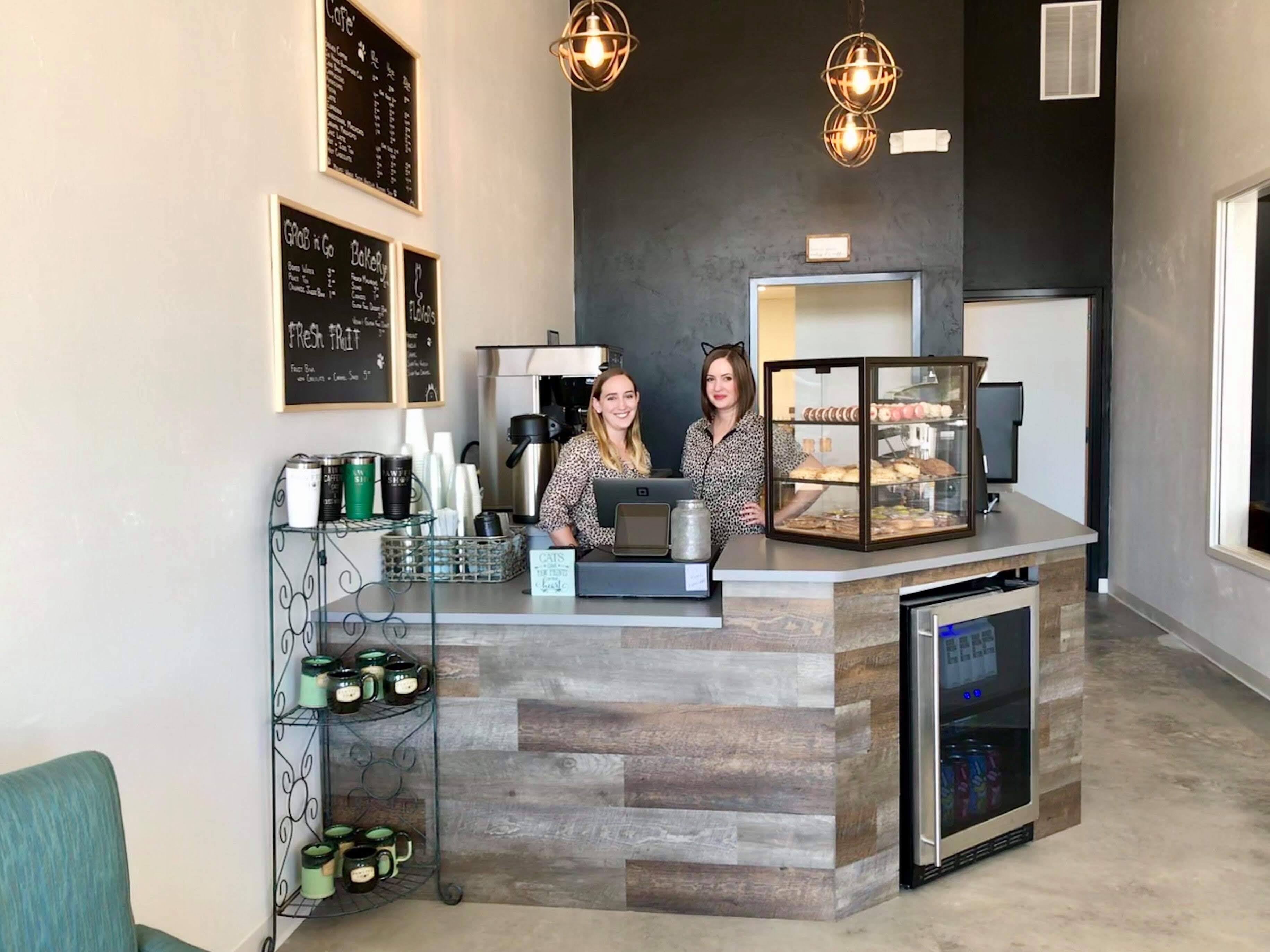 The Pawffee Shop Cat Café owners Leah Enking, left, and Elizabeth Feldhausen on the café side of their Grand Chute business.
