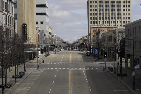 Downtown Appleton sidewalks and streets are mostly empty due to the coronavirus.