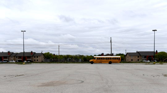 An AISD wifi school bus idles in a parking lot on Judge Ely Boulevard on Tuesday.