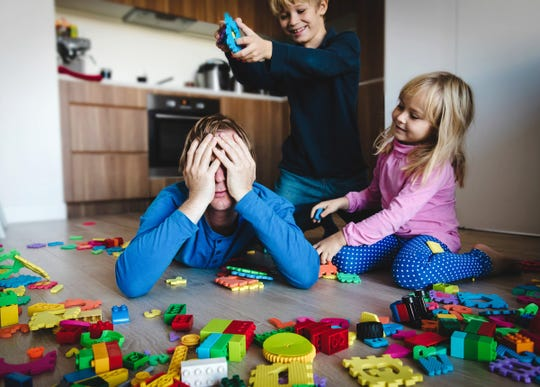 Kids play with scattered toys