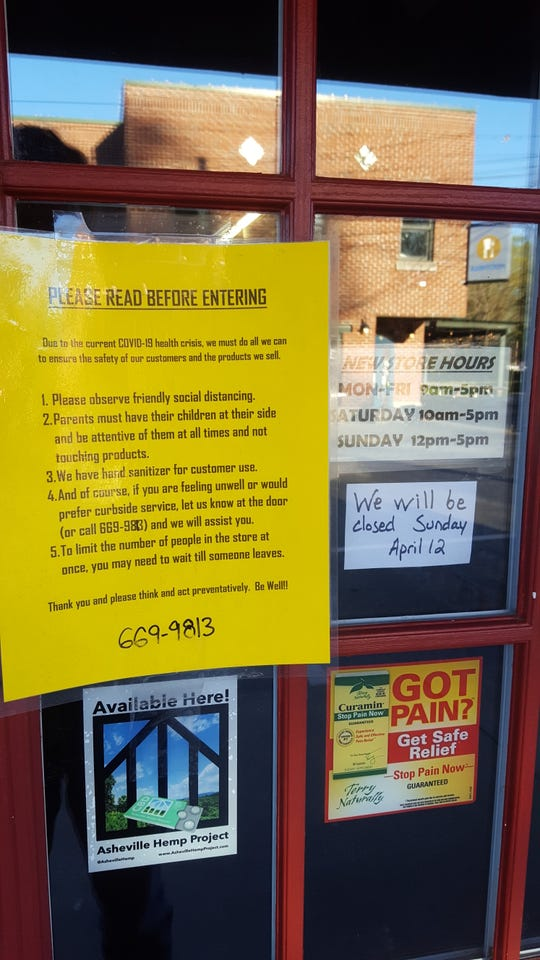 A notice posted on the door of Black Mountain Natural Foods, which is taking a number of safety precautions amid the coronavirus outbreak.