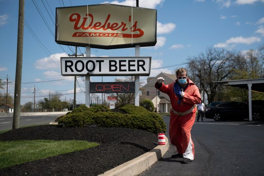 Weber's Drive In Pennsauken has hot dogs that customers love. Root beer, too. This file shot shows Elvis impersonator Mark McMichael while posing at the shop. McMichael has been an Elvis impersonator since the early 1990s.