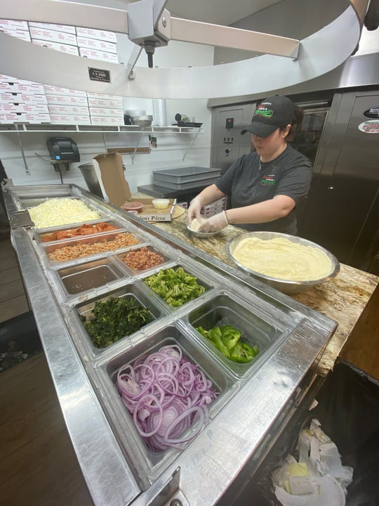 Samantha DeSimone, a manager at Danny's Pizza Pizzazz in Franklinville, makes pizza kits for students in Delsea Regional High School's Scholastic Adaptive Vocational Education (SAVE) program.