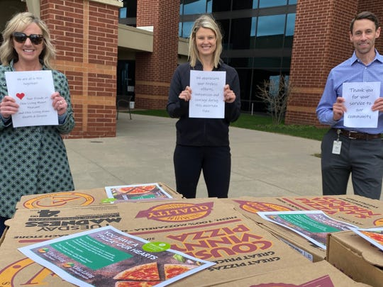 Delivering more than 100 pizzas from Cousin Vinny's Pizza in Middletown to Atrium Medical Center were (from left): Kristen Bowman, Nurse Liaison for Ohio Living Home Health; Maria Clark, Transitional Liaison for Ohio Living Mt. Pleasant; and Mark Hasselbeck, Regional Director of Business Development for Ohio Living Home Health.