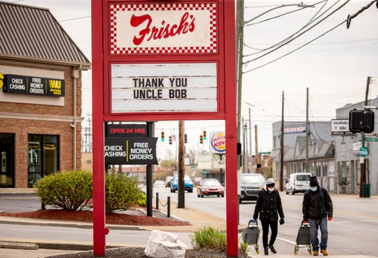 "Frisch's Big Boy in Western Hills posted the sign, ""Thank you, Uncle Bob,"" on Tuesday, April 14, 2020.  A hearse carrying Bob James led a procession from Our Lady of Lourdes to Elder High School along Glenway Avenue for people to pay their final respects."