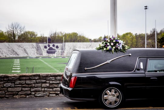 The hearse carrying Bob James parks in front of Elder High School on Tuesday, April 14, 2020 in West Price Hill. James graduated from Elder in 1960. He and his family have been heavily involved in Elder and the athletic program for decades.