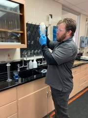 Clarksville Gas & Water's Derek Bumpus runs a test at the water treatment plant, where employees are staying to ensure it keeps going during the coronavirus outbreak.
