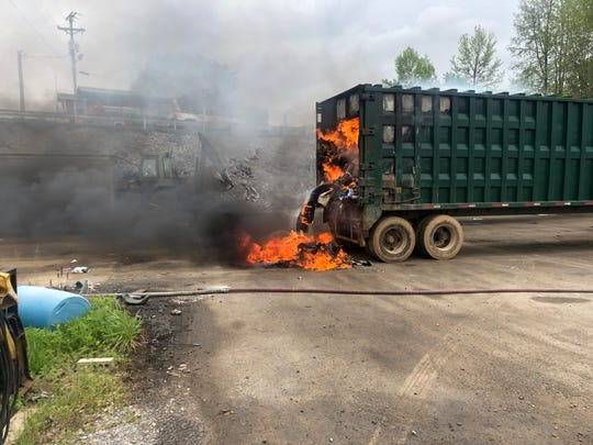 Clarksville Fire Rescue puts out a blaze that erupted inside a trailer at the Bi-County Landfill transfer station on Highway Drive on Tuesday, April 14, 2020.