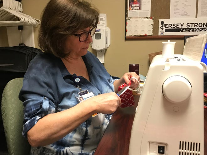 Margaret Grande, office coordinator, Medical Staff Quality and Patient Safety, sews masks at Hunterdon Medical Center.