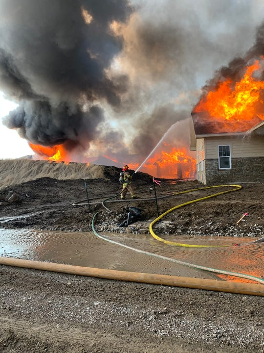 Firefighters try to put out a blaze Monday, April 13, 2020 at 8950 Coachlight Drive in West Des Moines.  The address near Jordan Creek Town Center is the site of a sprawling assisted-living facility that is still under construction.