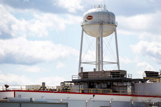 A water tower at a Tyson Foods processing plant is seen April 14 in Columbus Junction.