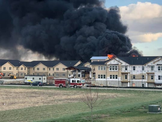 Firefighters try to put out a blaze Monday, April 13, 2020 at 8950 Coachlight Drive in West Des Moines.