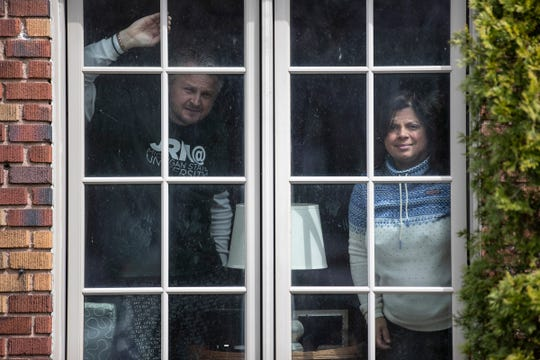 Free Press reporters M. L. Elrick and Tresa Baldas at their home in Detroit on April 14, 2020.