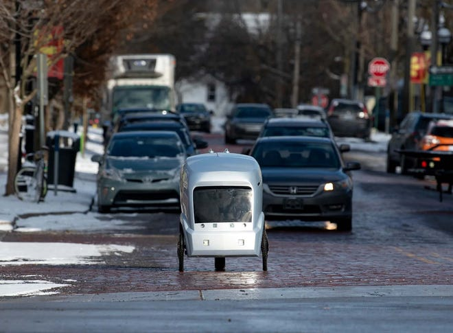 The autonomous REV robot - made by Rafraction AI in Ann Arbor - has seen food deliveries quadruple since the COVID crisis began.