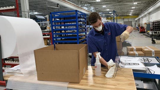 Employees at Mahindra Group's Auburn Hills plant are making aerosol boxes that protect nurses and doctors treating COVID-19 patients. The boxes are made from the same material used in the windshields of Mahindra's vehicles.