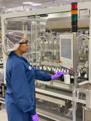 Perrigo Co. plc employees at its New York facility are making thousands of bottles of hand sanitizers for West Michigan hospitals and the state police amid the COVID-19 pandemic.