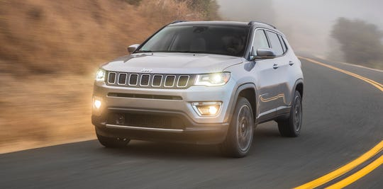 FCA is recalling more than 550,000 pickup trucks and SUVs worldwide, including the 2020 Jeep Compass shown, because the windshield wiper arms can come loose and stop the wipers from working properly.