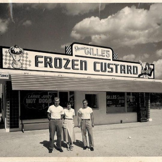 Tom Gilles, left, his only carhop (name unknown) and employee Johnny Petroff on opening day of Gilles Frozen Custard in Fond du Lac in July, 1949