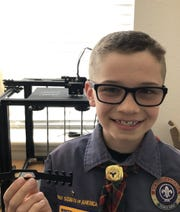 Gavin Kendrot, 10 of Windsor, is using his 3D printer to make ear guards for local healthcare workers.