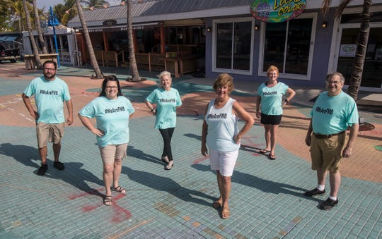 From left, Capt. Justin Paulauskis, Amy Austin, Marcee Anderson, Jan Fleming, Kelly Smith and David Anderson represent a group of businesses and volunteers who are selling #WeAreFMB T-shirts and taking donations  through the Fort Myers Beach Community Foundation with proceeds going to buy Publix gift cards for people in the service and tourism industry that have been hit so hard by the COVID-19 pandemic.