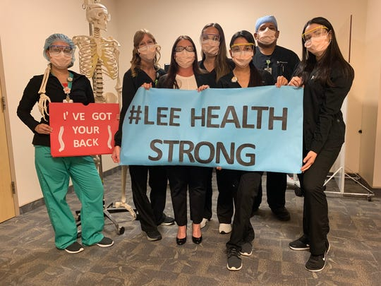 Lee Health medical staff pose for a photo recently to remind the community that they are working hard for us battling the coronavirus.