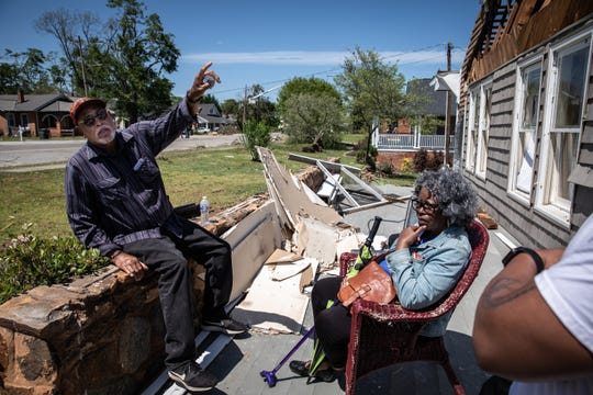 James Williams and his wife Gwendolyn Williams sit in what was their enclosed porch of their home in Seneca, Tuesday, April 14, 2020, after an EF3 tornado with 160 mph winds touched down early Monday destroying it and their roof.
