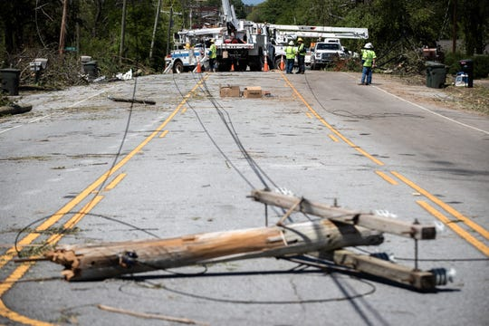 Utility workers begin assessing damage in Seneca Tuesday, April 14, 2020, after an EF3 tornado with 160 mph winds touched down early Monday.