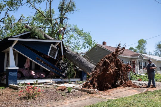 A house in Seneca which was crushed by a downed tree when an EF3 tornado with 160 mph winds touched down early Monday, April 13, 2020.