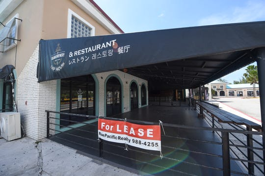 """A """"For lease"""" sign hangs outside The Guam Brewery Tap House and Restaurant during the COVID-19 outbreak, Tumon, April 14, 2020."""