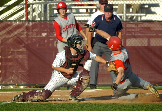 Henderson County catcher Kyle Gibson tags Daviess County's Landon Camp at home for a out during a May 12, 2008 game at Colonel Field.