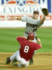 Henderson County second baseman Aaron Hauser receives the ball a little too late as Ballard's Spencer Graeter (8) steals the base during the June 16, 2000, state championship game in Lexington.