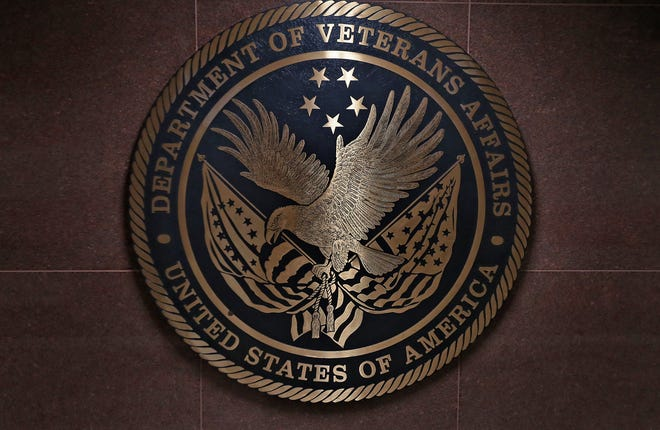 A wall medallion shows the U.S. Department of Veterans Affairs logo at Roudebush VA Medical Center, Thursday, April 9, 2020.