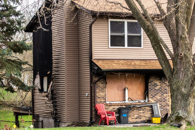 Fire damage is seen at a duplex, Tuesday, April 14, 2020, at 1900 North Ridge Drive in Coralville, Iowa.