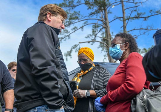 Gov. Tate Reeves speaks with Soso, Miss. resident Susie Carmichael, whose sister died during the tornado that struck over the weekend, at First Baptist Church Soso Tuesday, April 14, 2020.
