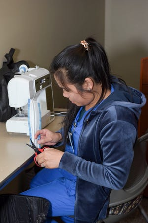 Several Jackson-Madison County General Hospital staff sewed masks for their coworkers, including laundry service worker Catherine Throckmorton who is pictured here.