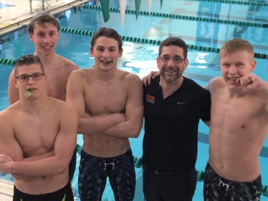 Brighton coach Jason Black poses with his 400-yard freestyle relay team of (from left) Jeremiah Lindauer, John McHugh, Leighton Brien and Remy Fischer.